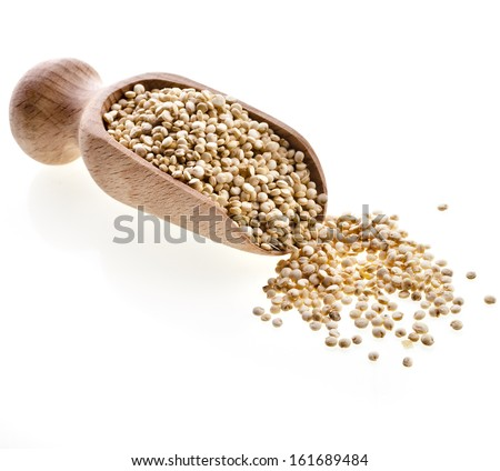 quinoa seed grain  in a wooden bowl scoop close up isolated on a white background #161689484