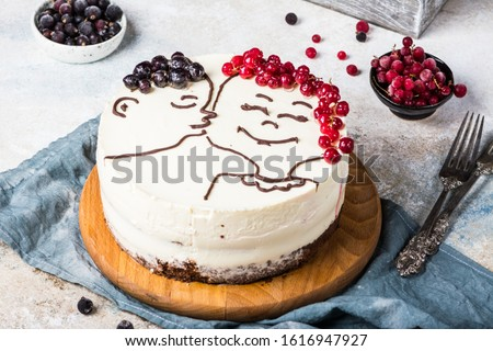 St. Valentine's Day, Mother's Day, Birthday Cake. festive dessert. Woman's day cake. Cake for valentines day. Valentines dessert. Cheesecake with berries. Love. Kissing figures #1616947927