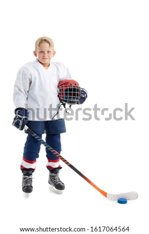 Junior ice hockey player . Child (boy) is hockey player in uniform with full equipment isolated on white background. Concept of children's sport, winter sport, healthy lifestyle. #1617064564