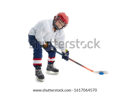 Junior ice hockey player . Child (boy) is hockey player in uniform with full equipment isolated on white background. Concept of children's sport, winter sport, healthy lifestyle. #1617064570