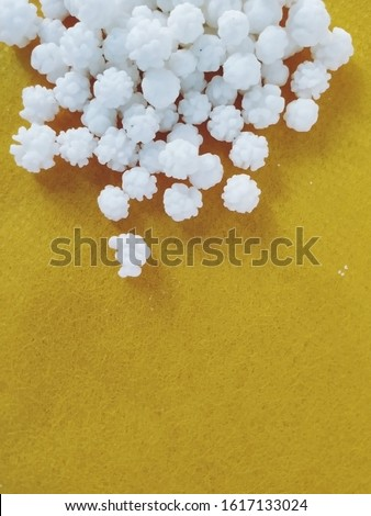Sugar Coated White Rough Balls for Making Pongal Distribution Food. Sugar coated white rough balls for distribution in Pongal and Sankranti festival #1617133024