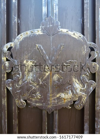 metal emblem with two lions and letter v #1617177409