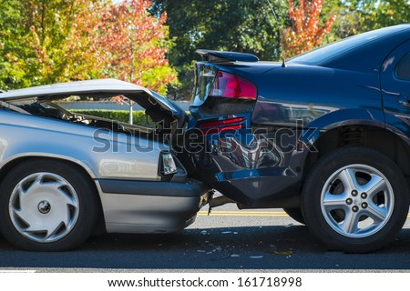 Auto accident involving two cars on a city street Royalty-Free Stock Photo #161718998