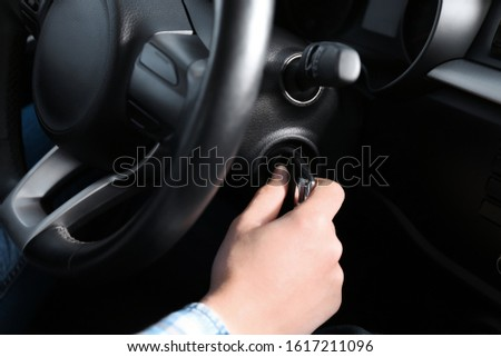 driver turns on engine ignition key #1617211096