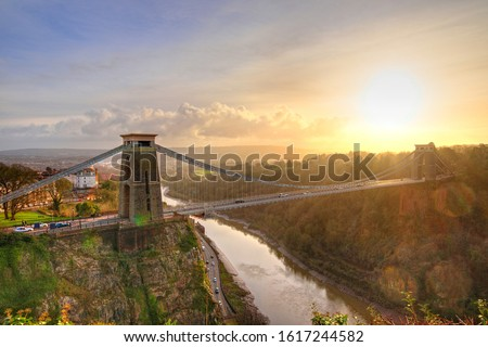 View in a winter sunset of the Clifton Suspension Bridge, a suspension bridge spanning the Avon Gorge and the River Avon in the city of Bristol, UK #1617244582