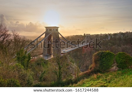 View in a winter sunset of the Clifton Suspension Bridge, a suspension bridge spanning the Avon Gorge and the River Avon in the city of Bristol, UK #1617244588