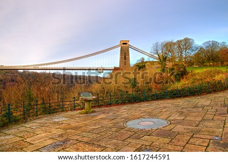 View in a winter sunset of the Clifton Suspension Bridge, a suspension bridge spanning the Avon Gorge and the River Avon in the city of Bristol, UK #1617244591