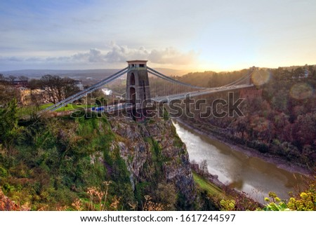 View in a winter sunset of the Clifton Suspension Bridge, a suspension bridge spanning the Avon Gorge and the River Avon in the city of Bristol, UK #1617244597