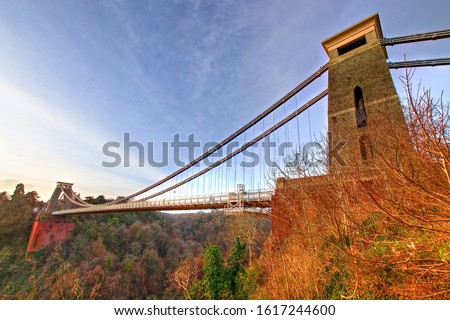 View in a winter sunset of the Clifton Suspension Bridge, a suspension bridge spanning the Avon Gorge and the River Avon in the city of Bristol, UK #1617244600