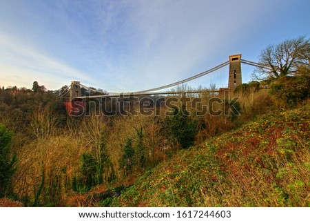 View in a winter sunset of the Clifton Suspension Bridge, a suspension bridge spanning the Avon Gorge and the River Avon in the city of Bristol, UK #1617244603