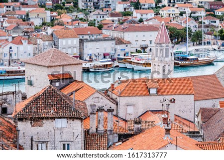 Tiled rooftops in old town and sea bay with boats #1617313777