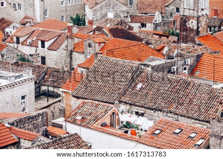 Tiled rooftops in old town #1617313783