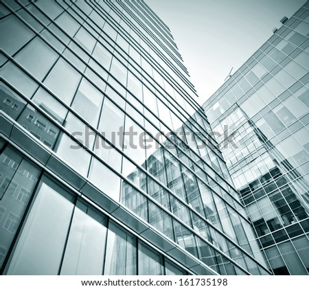 Panoramic and perspective wide angle view to steel blue background of glass high rise building skyscrapers in modern futuristic downtown at night Business concept of successful industrial architecture #161735198
