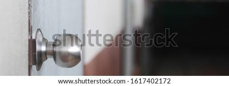 Doorknob on classroom door. Selective focus #1617402172