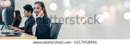 Business call center operator help service support team with headset microphone ready for service for banner and copy space. Royalty-Free Stock Photo #1617458446