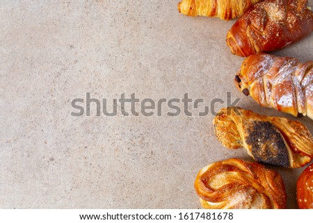fresh sweet bun assortment on granite background #1617481678