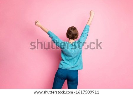 Back behind rear view photo of glad positive lucky girl raising hands up isolated pastel color background