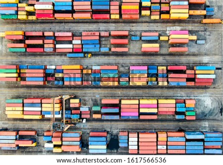 Container terminal in Port of Spain, aerial shot from above, many containers with different colors. #1617566536