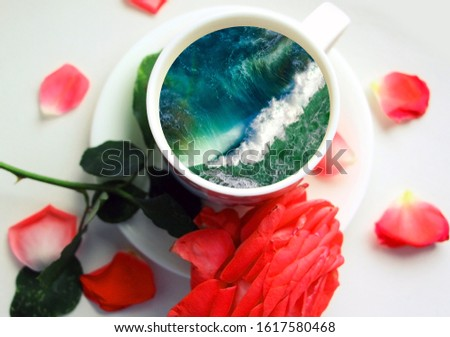 White cup with water. Sea. Ocean. Sea waves. Creative postcard. #1617580468