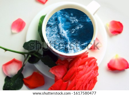 White cup with water. Sea. Ocean. Sea waves. Creative postcard. #1617580477