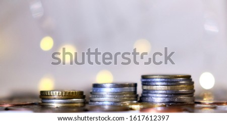 Coins stacked in stacks on a colored background with a side #1617612397
