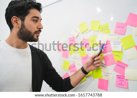 Creative people meeting at office and use post it notes to share idea. Man leading brainstorming. Brainstorming concept. #1617743788