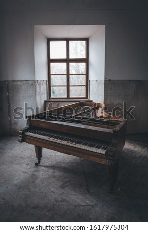 Old piano left in long abandoned chateau #1617975304