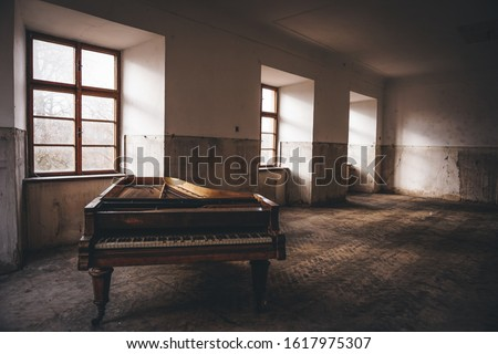 Old piano left in long abandoned chateau #1617975307