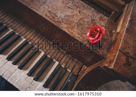 Old piano left in long abandoned chateau #1617975310