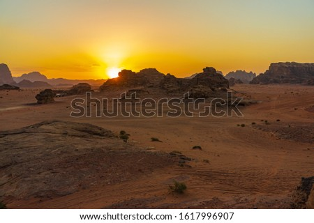 Vintage photos from archive. Jordan. Sunset in Wadi Rum desert. Martian landscapes in lifeless desert. Red rocks and red sand.  #1617996907