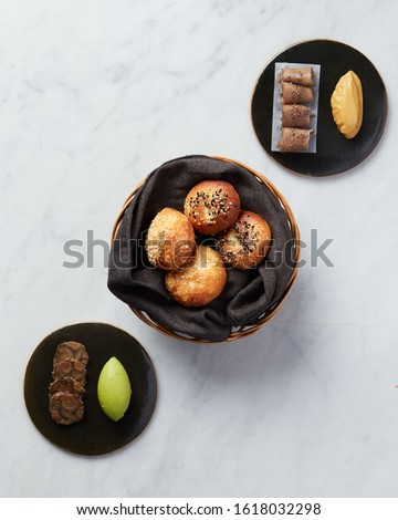 Delicious golden bread in a bucket with organic appetizers with a white background and focus #1618032298