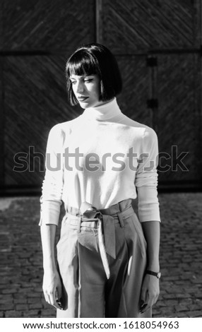 Girl makeup face wear loose high waisted pants. High waisted trousers keep returning to catwalk. High waisted. Woman attractive brunette fashionable outfit. Femininity and emphasize feminine figure. #1618054963
