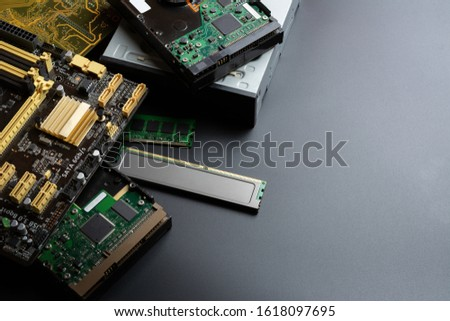 group of old and used computer component part on dark background. recycle and electronic waste concept. #1618097695