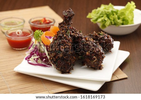 Delicious Tandoori Kebab. Grilled Indian snack on a platter with beautiful background. #1618169173
