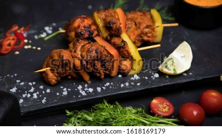 Delicious Tandoori Kebab. Grilled Indian snack on a platter with beautiful background. #1618169179