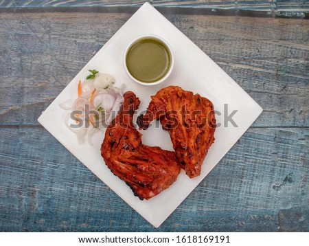 Delicious Tandoori Kebab. Grilled Indian snack on a platter with beautiful background. #1618169191