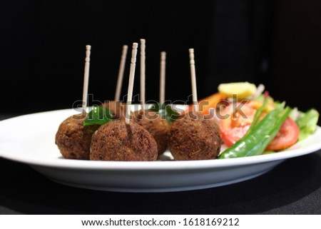 Delicious Tandoori Kebab. Grilled Indian snack on a platter with beautiful background. #1618169212