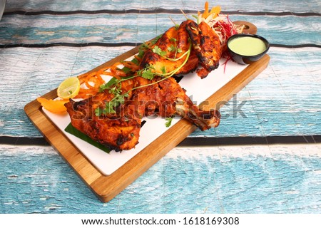 Delicious Tandoori Kebab. Grilled Indian snack on a platter with beautiful background. #1618169308