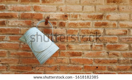 Old zinc watering pot hung on the wall,vintage style background,vintage style interior #1618182385