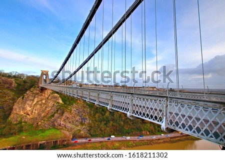 View in a winter sunset of the Clifton Suspension Bridge, a suspension bridge spanning the Avon Gorge and the River Avon in the city of Bristol, UK #1618211302