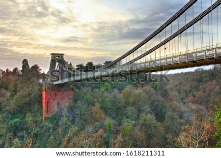 View in a winter sunset of the Clifton Suspension Bridge, a suspension bridge spanning the Avon Gorge and the River Avon in the city of Bristol, UK #1618211311