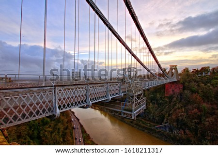 View in a winter sunset of the Clifton Suspension Bridge, a suspension bridge spanning the Avon Gorge and the River Avon in the city of Bristol, UK #1618211317