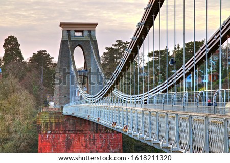 View in a winter sunset of the Clifton Suspension Bridge, a suspension bridge spanning the Avon Gorge and the River Avon in the city of Bristol, UK #1618211320