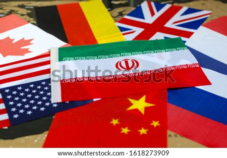 national flag of Iran on the background of the flags of the United States, Canada, Germany, France, great Britain, China, Russia	 #1618273909