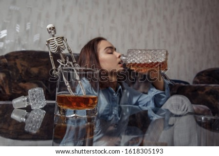 Young female drinks alcoholic beverage in depression and stress. Alcoholism addict. World No Alcohol Day. #1618305193