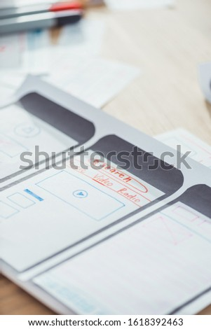 Selective focus of ui planning for mobile app on wooden table #1618392463