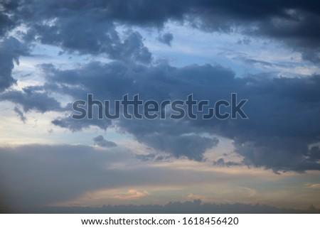 Dark clouds on evening sky, cumulus clouds high, beautiful aerial cloudscape view #1618456420