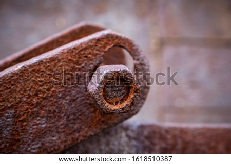 rusty iron with a rusty nut #1618510387