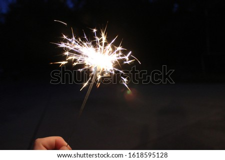 A sparkler glows in the night. #1618595128