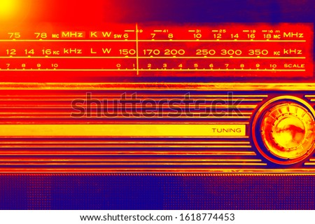 An old radio frequency tuning in abstract colorful style. Retro background. Retro music concept. Music radio sound wave. Classic vintage design. Radio station signal.